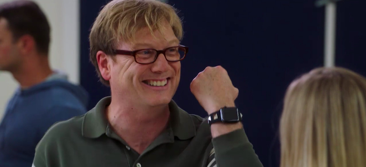Andy Daly as Dave fist-pumping and smiling