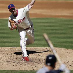 Philadelphia Phillies' Cliff Lee delivers against Atlanta Braves' David Ross in the second inning of a baseball game, Sunday, Sept. 23, 2012, in Philadelphia.