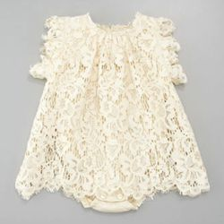 """Though it's more muted than either the styles both parents favor, we hope they'll dress their daughter in something like this D&G for special occasions.$435, <a href=""""http://www.neimanmarcus.com/p/Dolce-Gabbana-Lace-Dress-Ivory-3-24-mo-/prod154530631_cat1"""