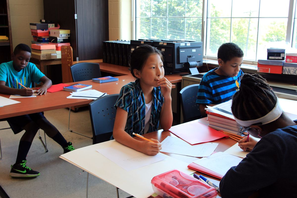 Amanda Zhou, 10, lists characteristics about herself during a self-awareness lesson at the Shelby County Summer Leadership Camp in Memphis.