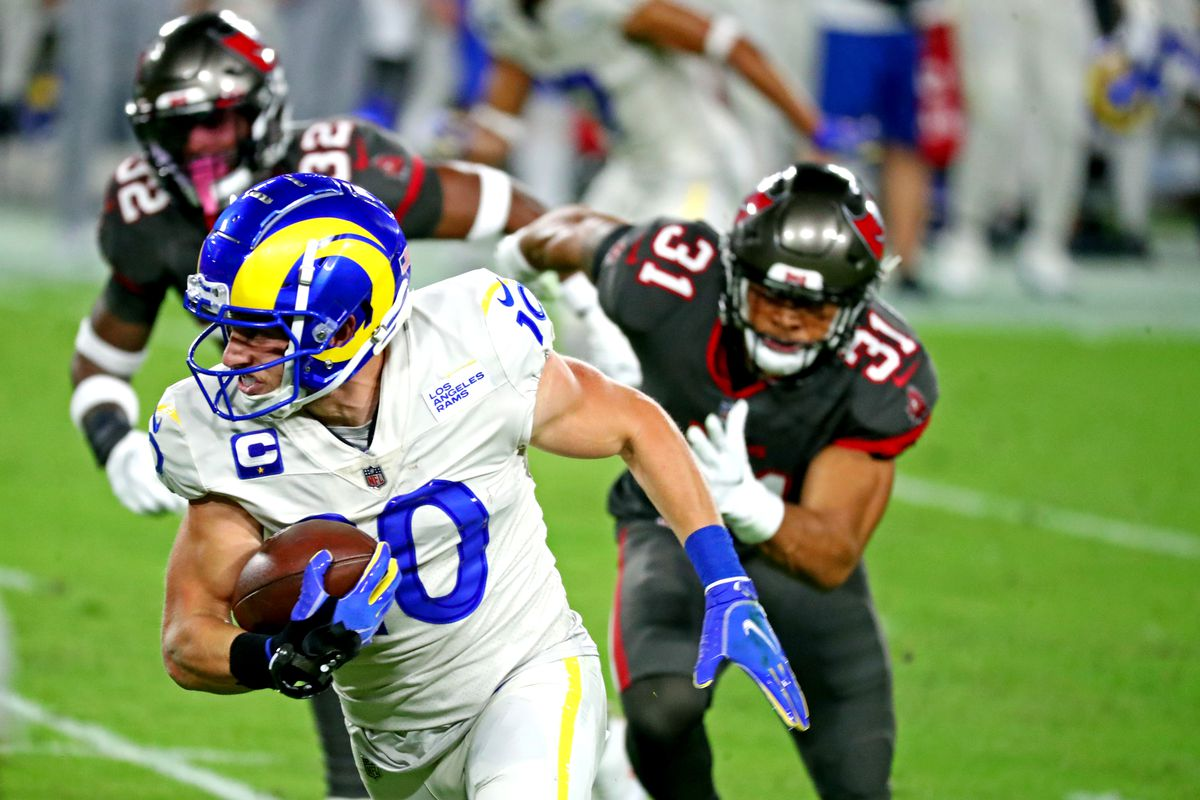 Los Angeles Rams wide receiver Cooper Kupp (10) runs with the ball against Tampa Bay Buccaneers strong safety Antoine Winfield Jr. (31) during the first quarter at Raymond James Stadium.