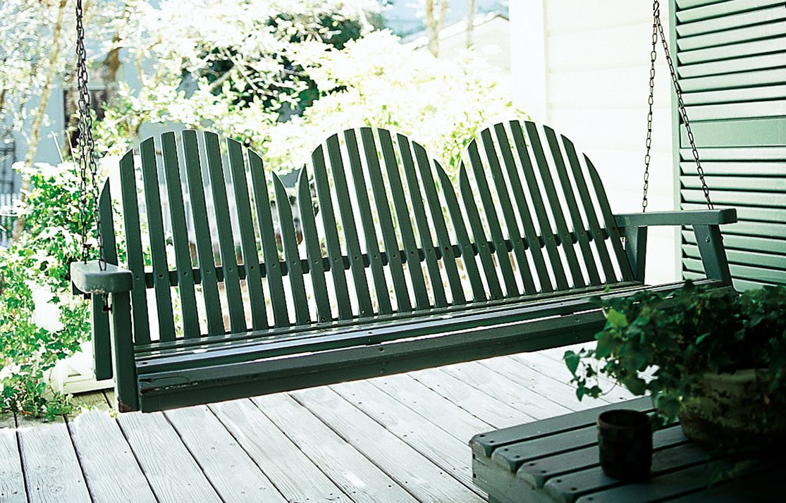 <p>A green-painted Adirondack-style swing with room for three.</p>