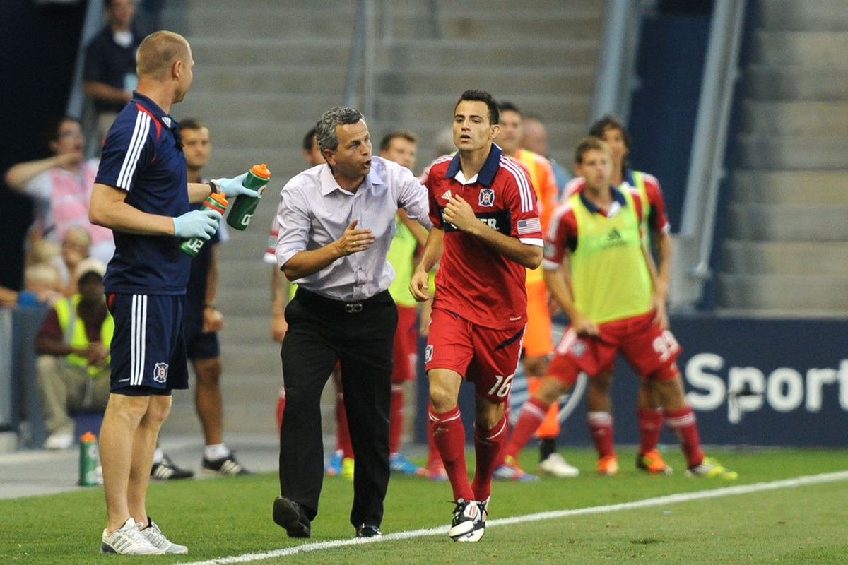 Jun 29, 2012; Kansas City, KS, USA; Chicago Fire midfielder Marco Pappa (16) is congratulated by head coach Frank Klopas (left) after scoring a goal against Sporting KC in the second half at Livestrong Sporting Park. Chicago won the game 1-0.