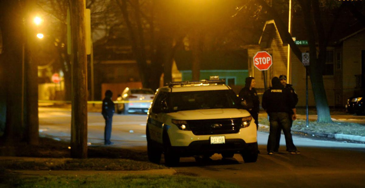 Police investigate the scene of a shooting in Gresham on March 28.   Justin Jackson/ Sun-Times