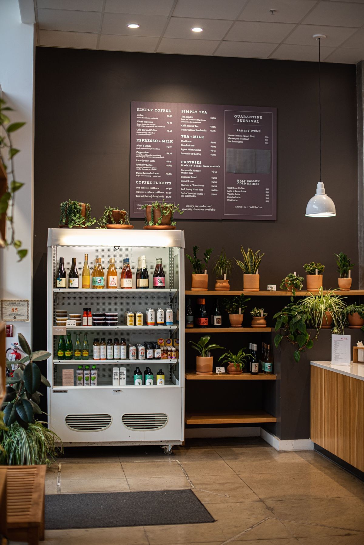 A takeout cooler and menu at a new coffee shop.