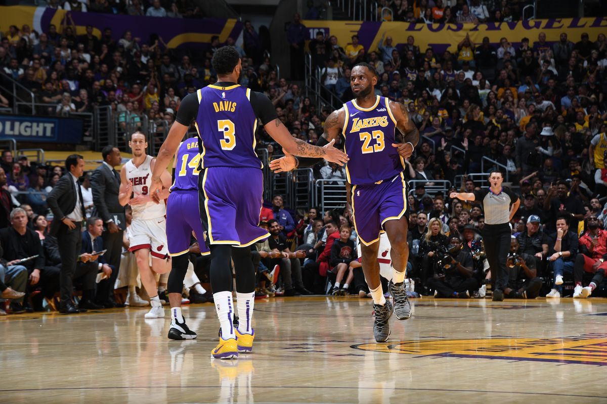 Anthony Davis and LeBron James of the Los Angeles Lakers hi-five each other against the Miami Heat on November 8, 2019 at STAPLES Center in Los Angeles, California.