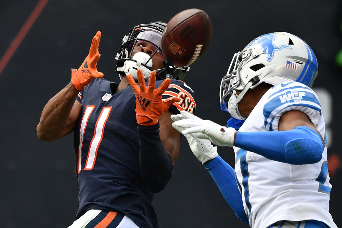 Darnell Mooney #11 of the Chicago Bears looks to make a catch against the Detroit Lions in the second half at Soldier Field on October 03, 2021 in Chicago, Illinois.