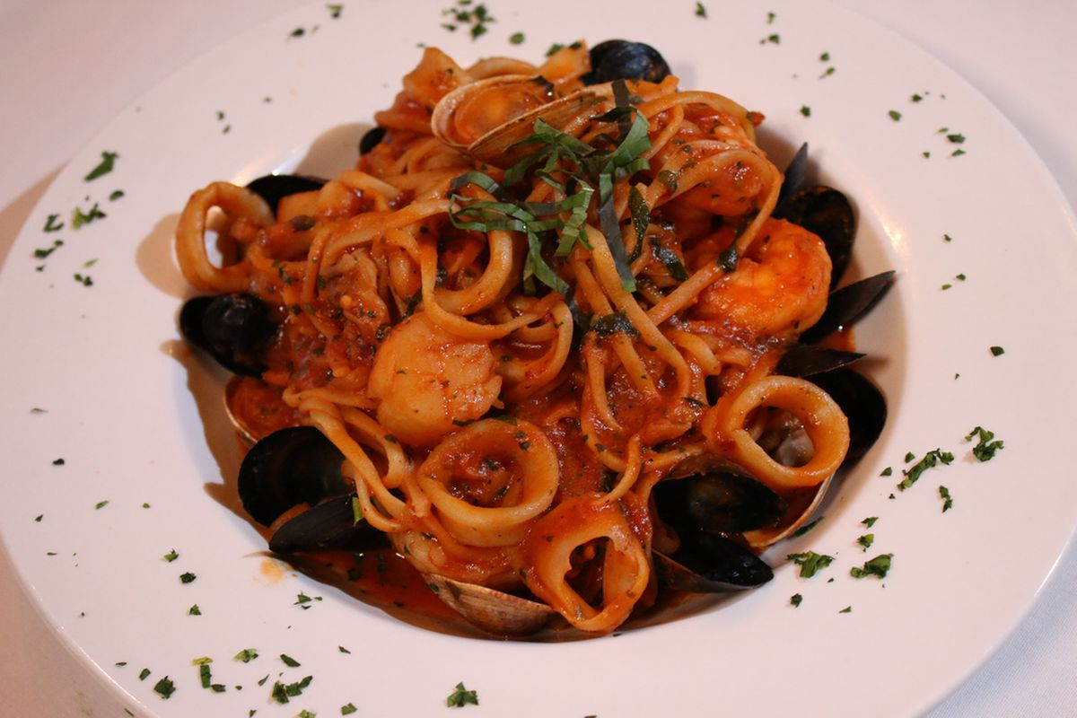 The Linguini Frutti Di Mare, served at Frankie's Ristorante, is made with long strand pasta, mussels, clams, calamari, shrimp, and scallops in red sauce.