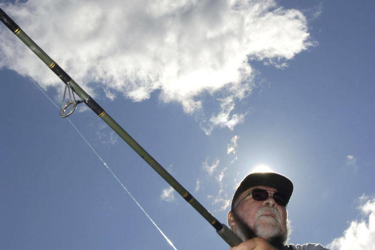 In this Aug. 8, 2012, photo, Sid Smith has the sun on his back as he fishes for pink salmon on the Kenai River in Soldotna, Alaska. Sportfishing closures around the state in 2012 have guides considering better ways to communicate with clients about opport