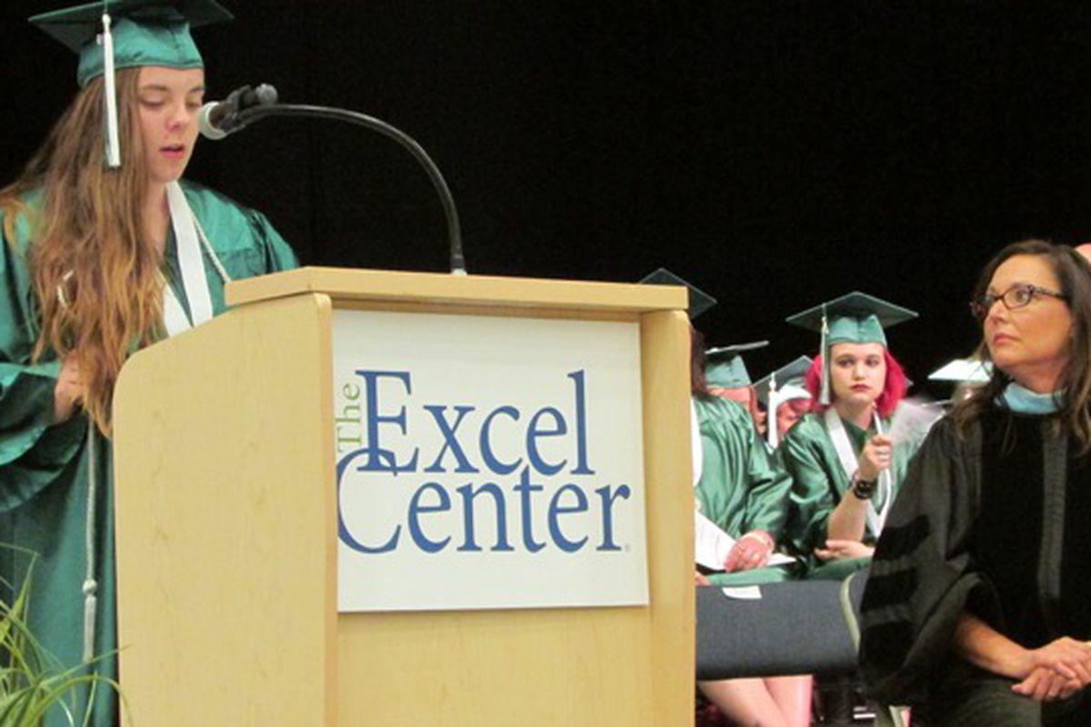 Excel Center graduate Heather Brown speaks to her classmates.