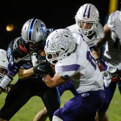 Stansbury's Brock Wilson (23) gets pressed by Tooele's defense during a high school football gameat Stansbury High School in Stansbury Park on Friday, Sept. 17, 2021.