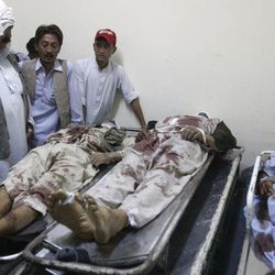 Pakistani Shiite Muslims identify the bodies of their relatives, killed by unknown gunmen, at a local hospital in Quetta, Pakistan on Saturday, Sept. 1, 2012. A group of gunmen on motorcycles in the southwestern province of Baluchistan killed several Shiite Muslims, as violence against the minority sect continues to escalate.