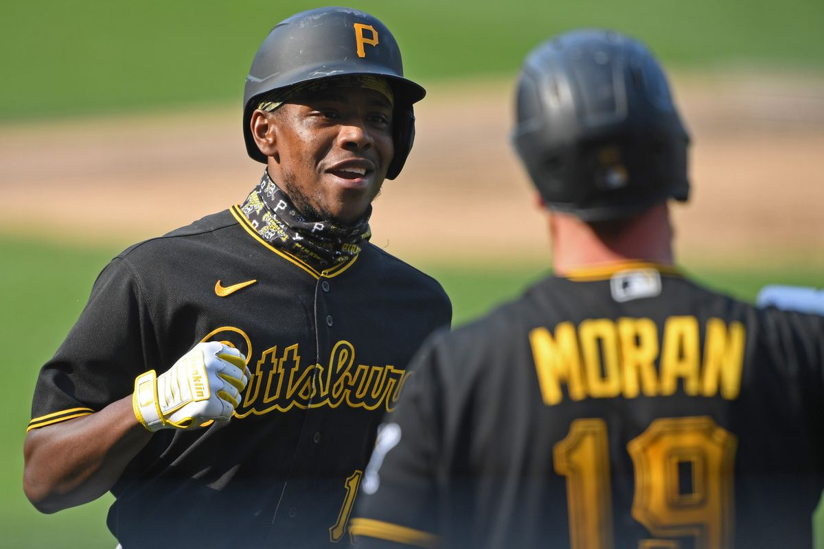 Pittsburgh Pirates third basemen Ke'Bryan Hayes is congratulated by designated hitter Colin Moran after hitting a solo home run in the third inning against the Cleveland Indians at Progressive Field.