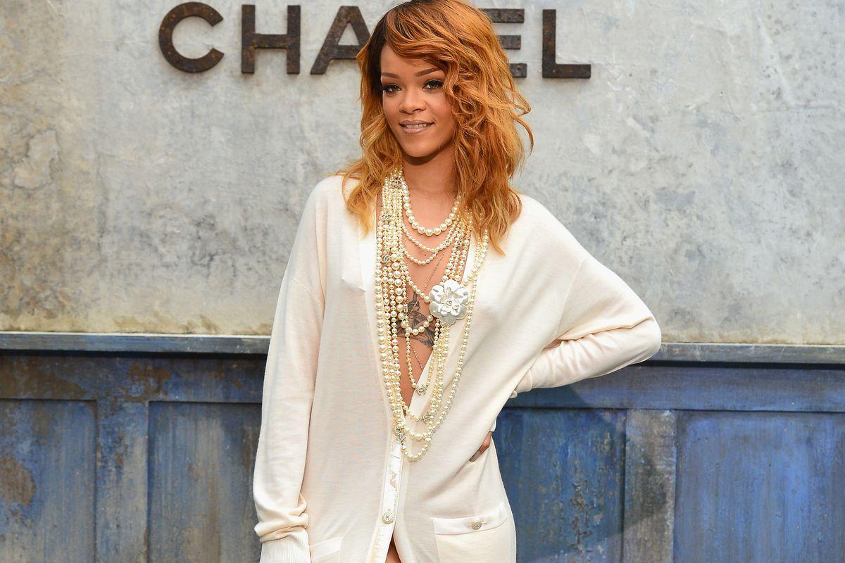 Rihanna flaunts pearls, nipple jewelry at Chanel. Photo via Getty.