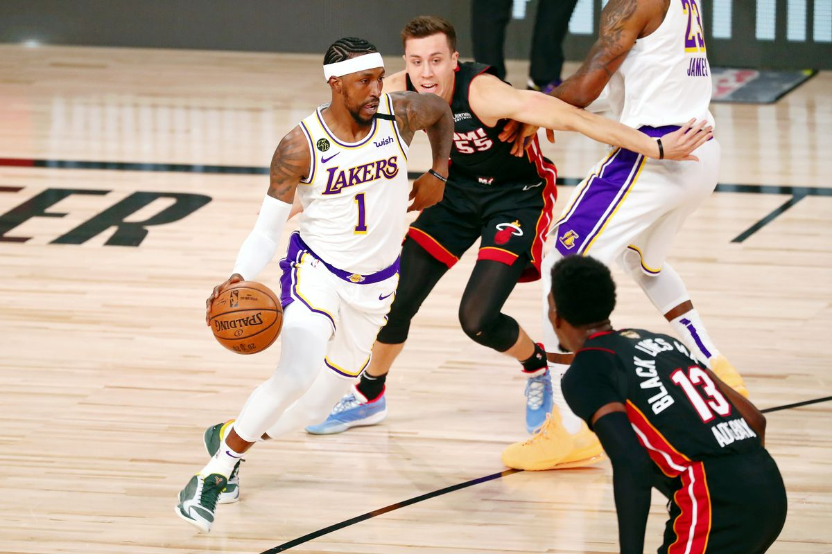 Los Angeles Lakers guard Kentavious Caldwell-Pope dribbles as Miami Heat guard Duncan Robinson pursues during the first quarter in game six of the 2020 NBA Finals at AdventHealth Arena.