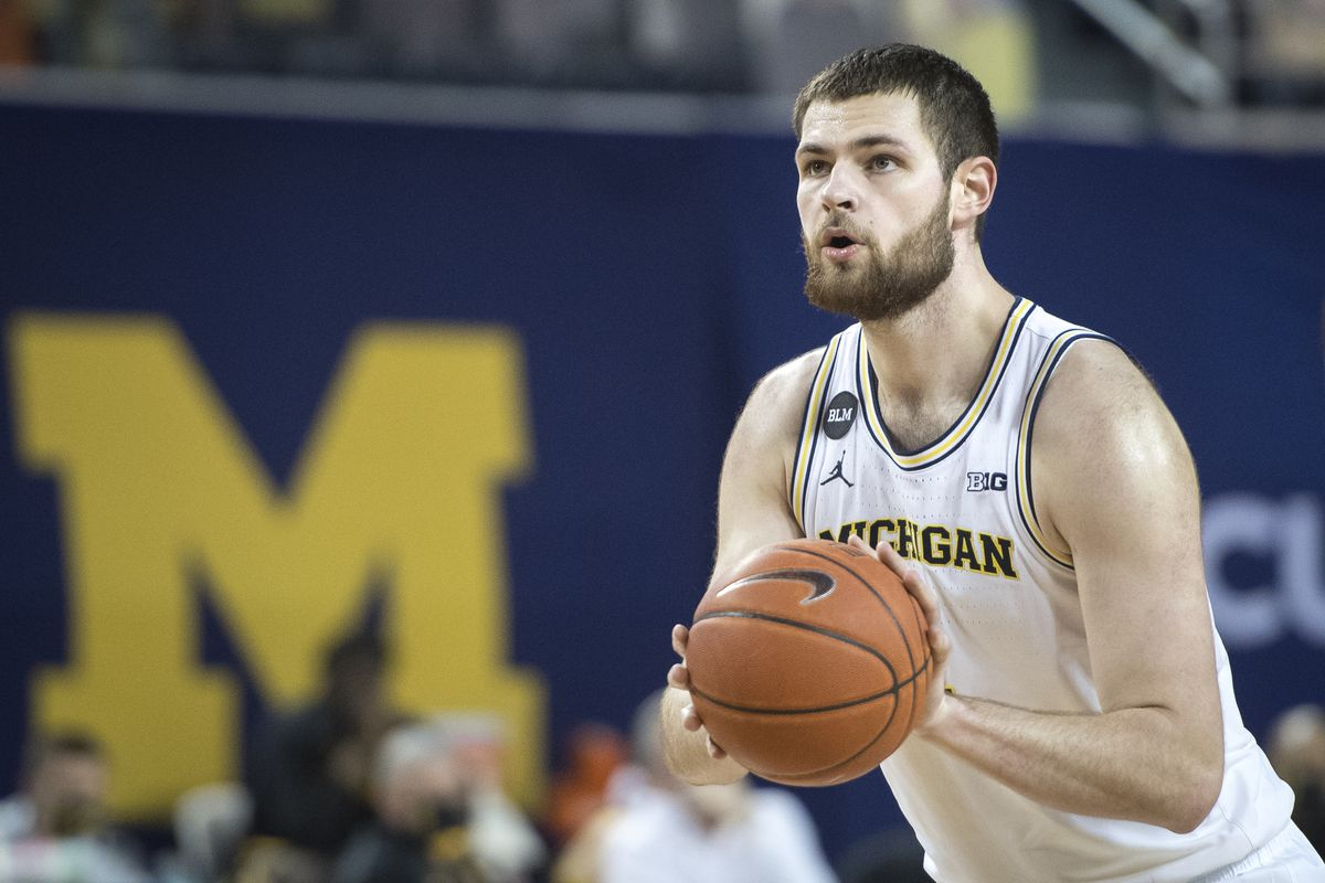 Hunter Dickinson of the Michigan Wolverines shoots a free throw against the Iowa Hawkeyes during the second half at Crisler Arena on February 25, 2021 in Ann Arbor, Michigan.