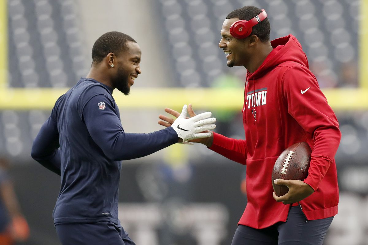 Kareem Jackson #22 of the Denver Broncos and Deshaun Watson #4 of the Houston Texans greet each other during warm ups before the game at NRG Stadium on December 08, 2019 in Houston, Texas.