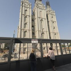 Visitors look over the Salt Lake Temple during the 190th Semiannual General Conference of The Church of Jesus Christ of Latter-day Saints in Salt Lake City on Saturday, Oct. 3, 2020.