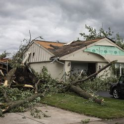 Several homes sit severely damaged on Evergreen Lane near Chestnut Avenue in Woodridge after a tornado ripped through the western suburbs overnight, Monday morning, June 21, 2021.
