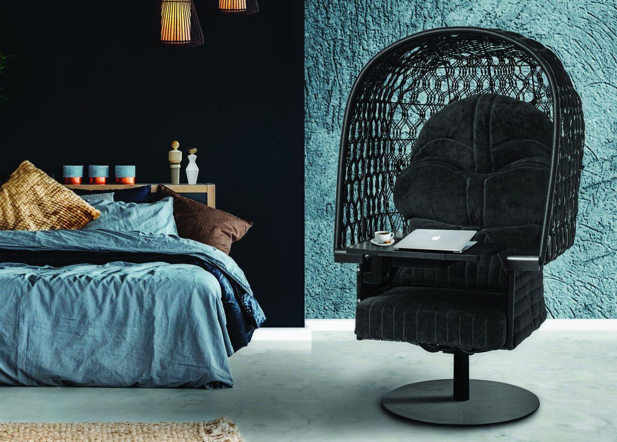 Dark armchair in blue bedroom