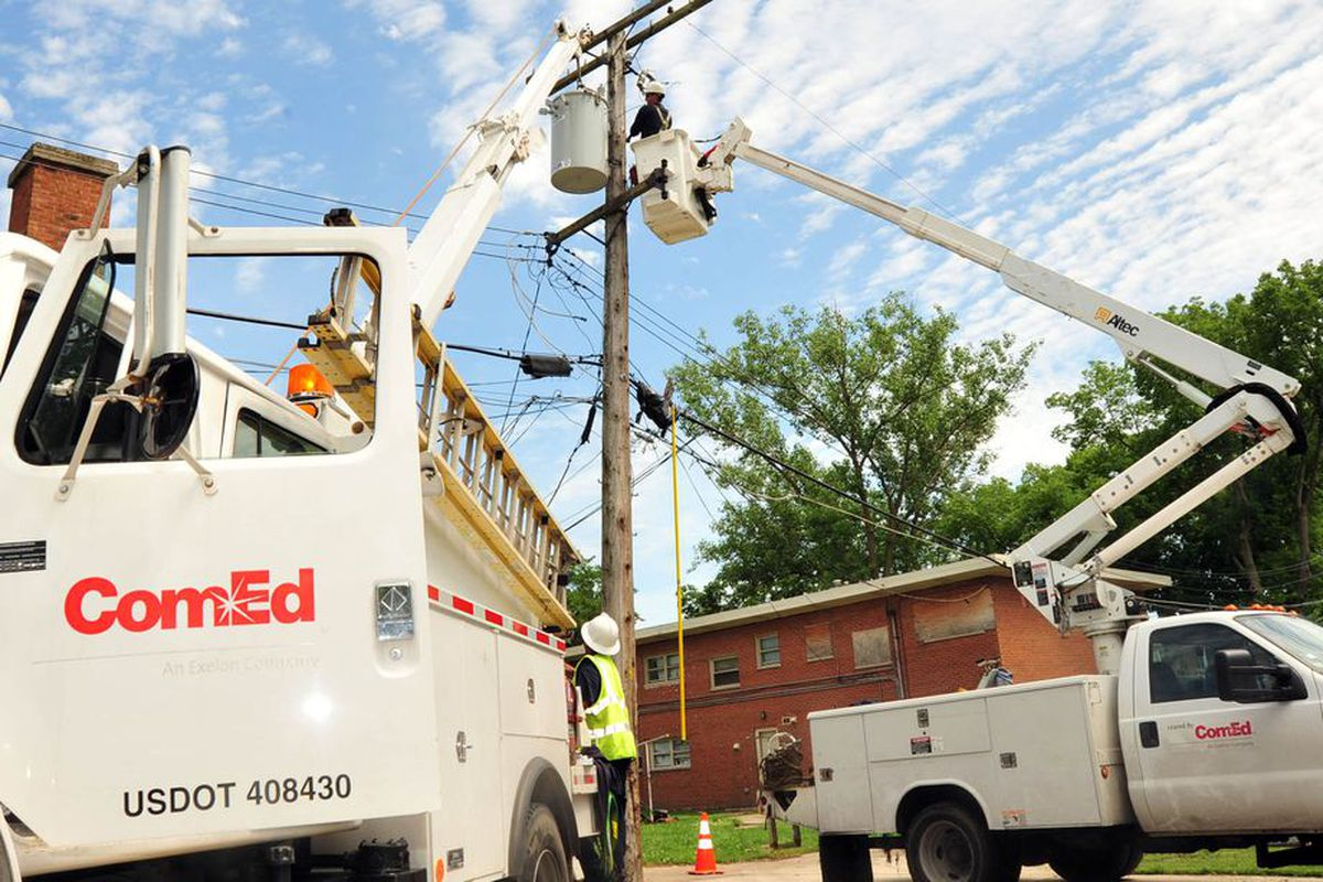 A ComEd crew works on a utility poll.