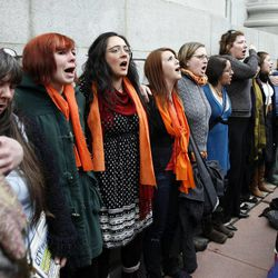 People gathered to support Tim DeChristopher sing following a guilty verdict for DeChristopher on two federal charges in Salt Lake City on Thursday, March 3, 2011.