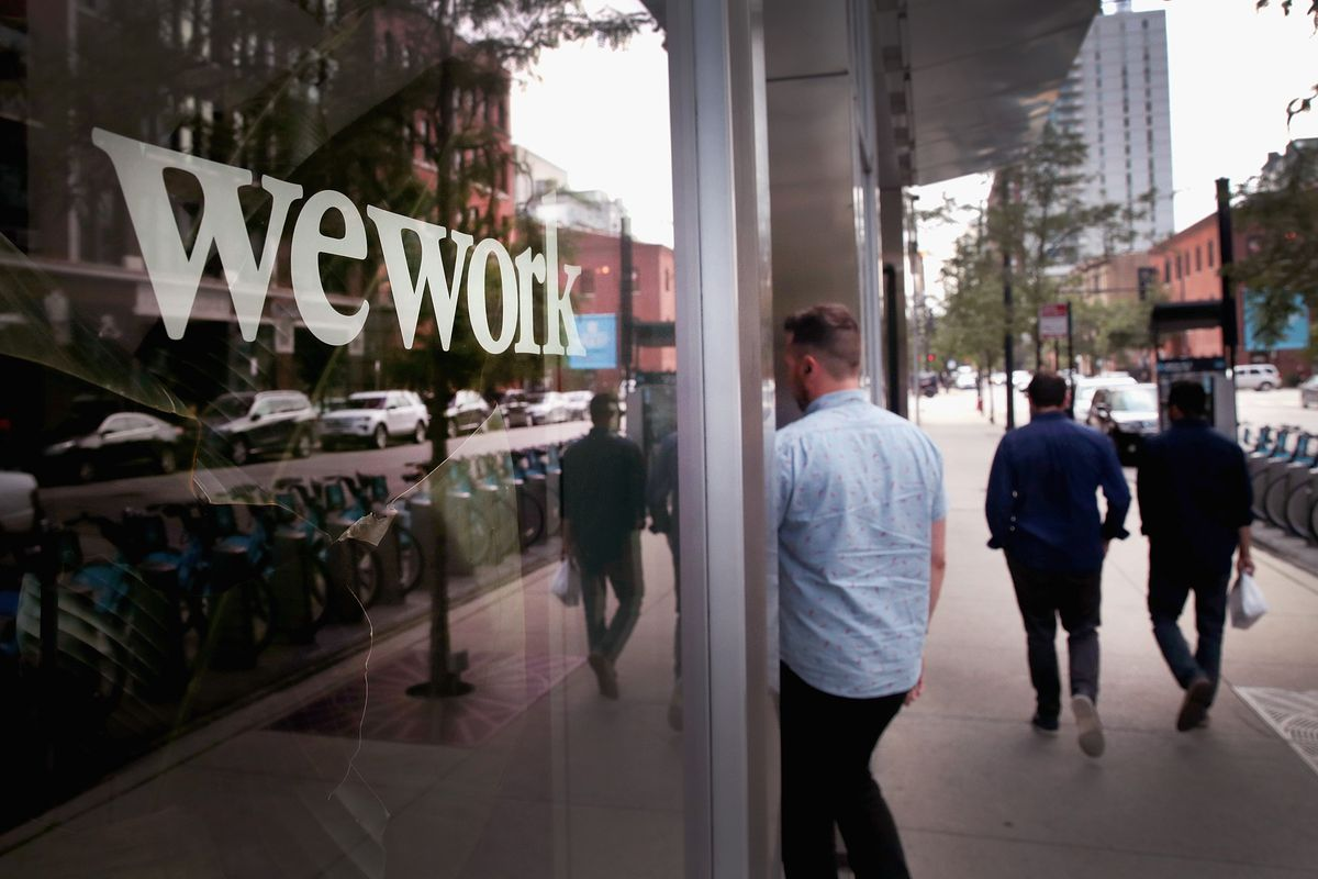 People walk past a WeWork office in Chicago.