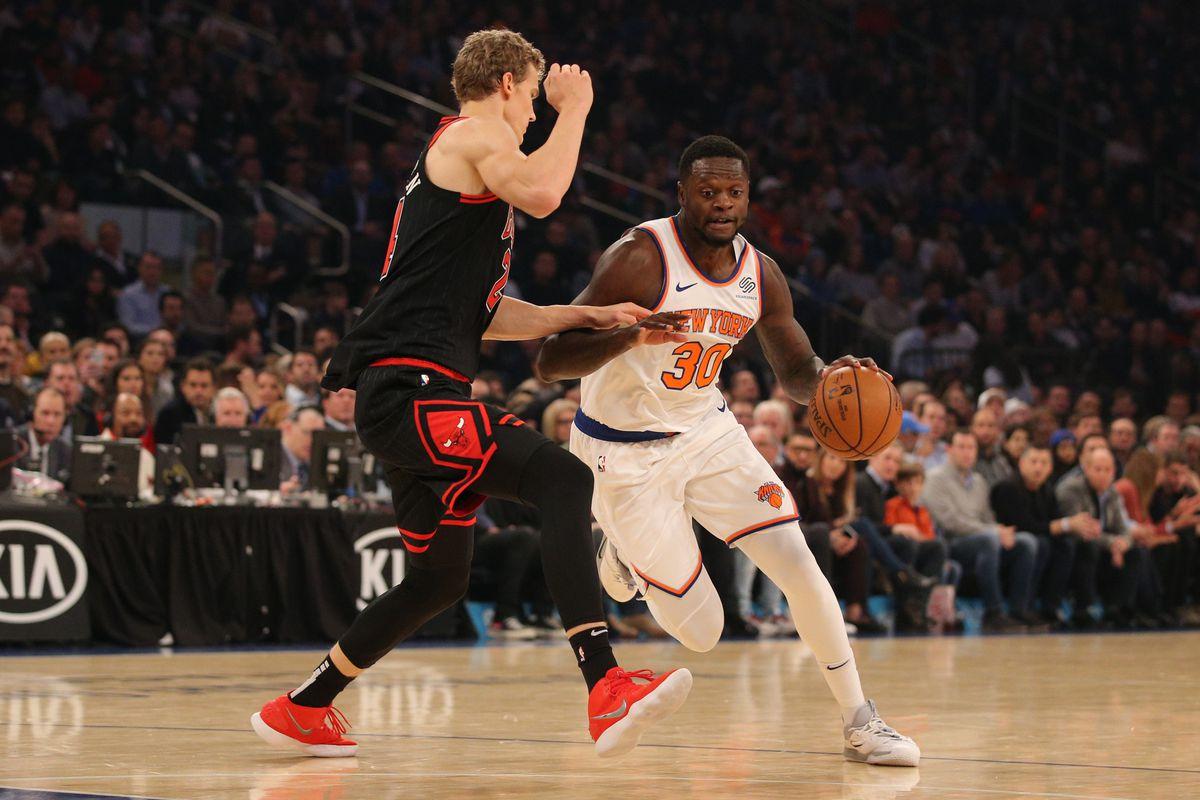 New York Knicks center Julius Randle controls the ball against Chicago Bulls power forward Lauri Markkanen during the first quarter at Madison Square Garden.