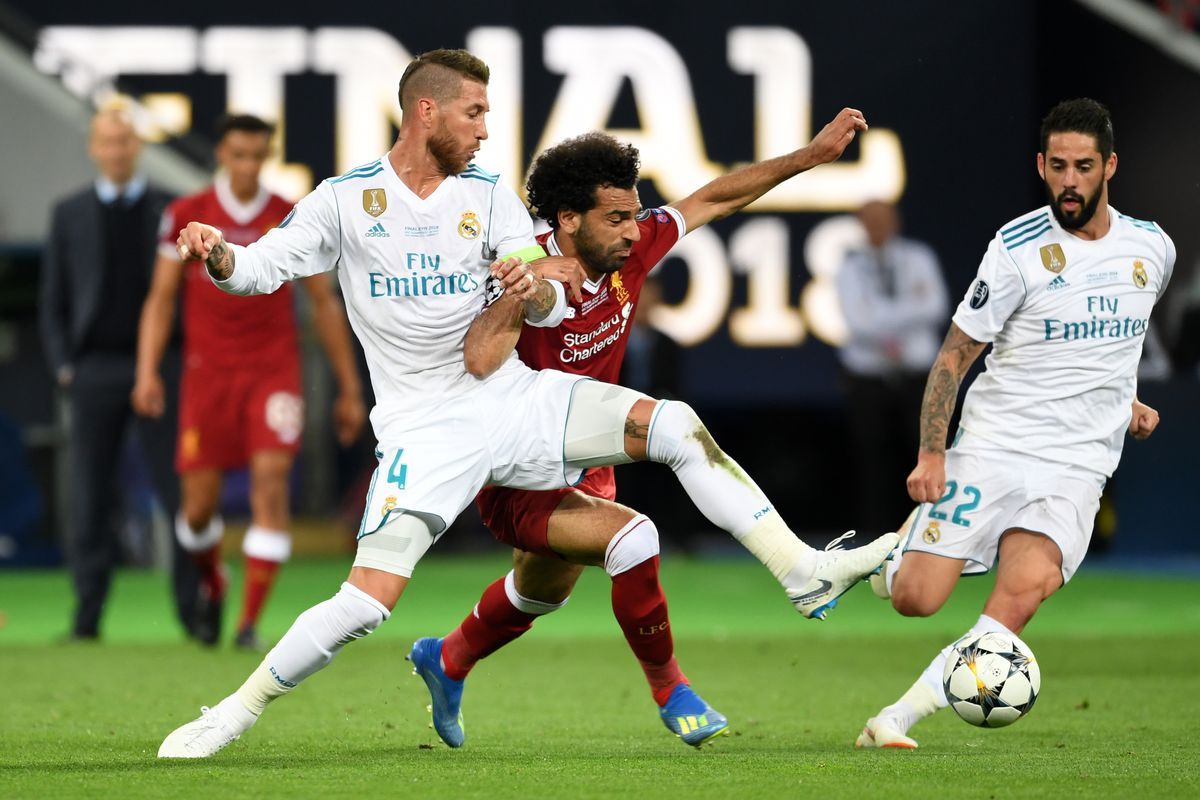 Sergio Ramos pulls down Mo Salah in what is deemed not a foul during the UEFA Champions League final between Real Madrid and Liverpool at NSC Olimpiyskiy Stadium on May 26, 2018 in Kiev, Ukraine.