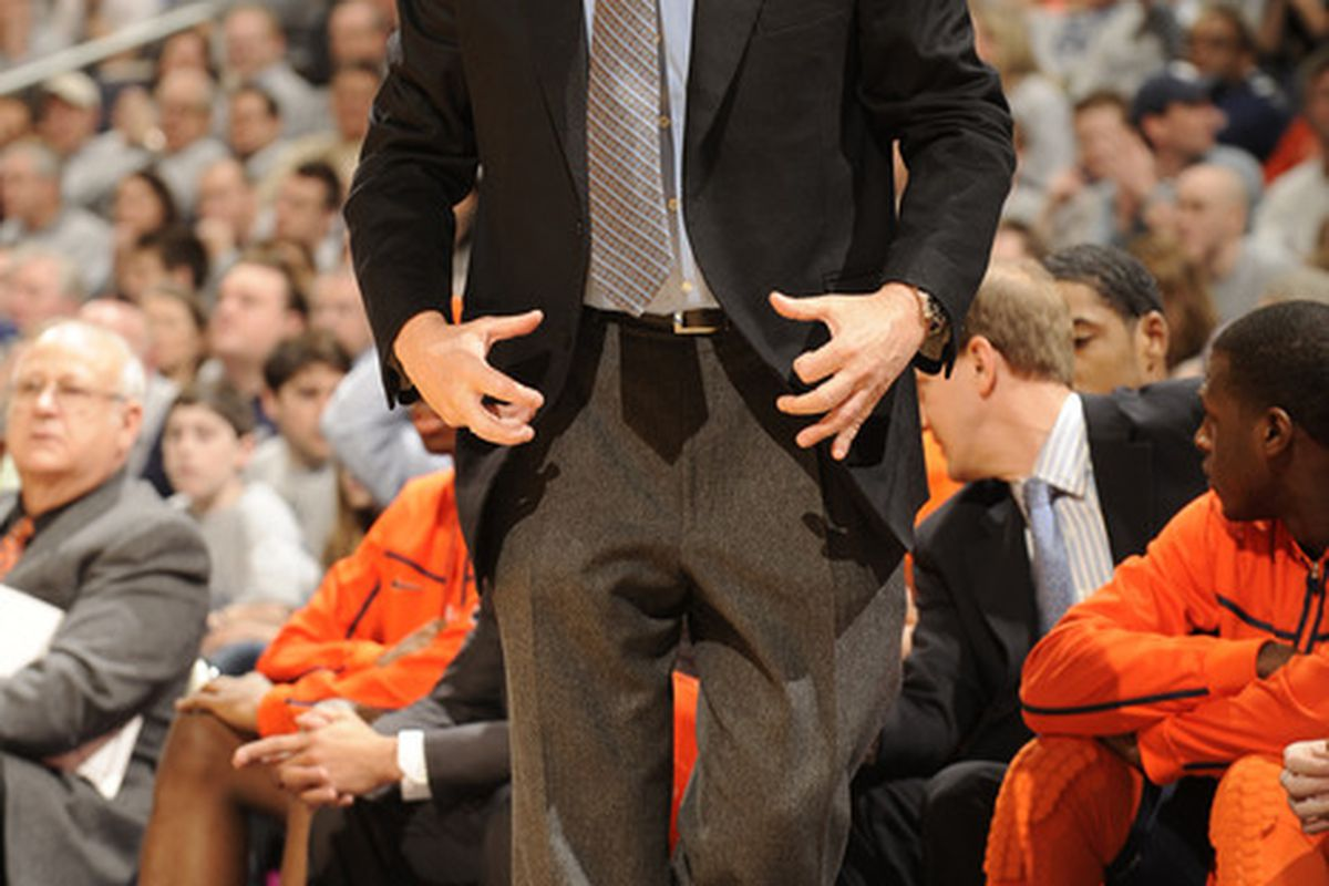 Jim Boeheim putting on his imaginary championship belt.  (Photo by Mitchell Layton/Getty Images)