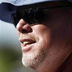 Former BYU quarterback Jim McMahon speaks to reporters at Riverside Country Club in Provo as part of BYU's quarterback week on Friday,  September 3, 2010.  The event raises athletic endowment funding.