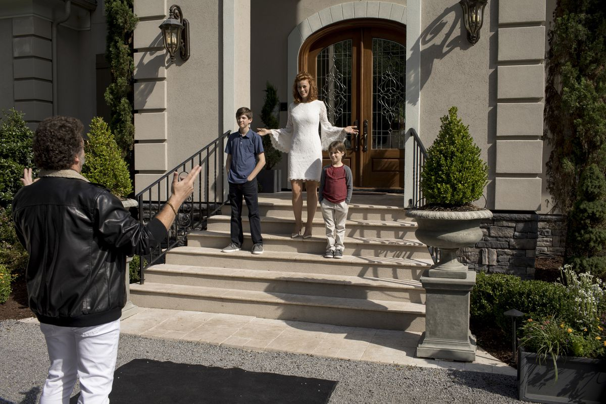 Jesse (McBride) stands in front of his two sons (Kelton DuMont and Gavin Munn) and his wife Amber (Cassidy Freeman) in The Righteous Gemstones