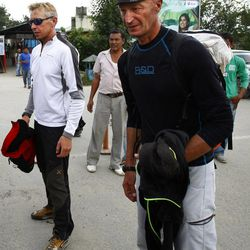 Unidentified Italian survivors of Sunday's avalanche at Mount Manaslu arrive in Katmandu, Nepal, after being flown from the mountain, Monday, Sept. 24, 2012. Rescue helicopters flew over the high slopes of the northern Nepal peak again Monday to search for climbers lost in an avalanche that killed at least nine mountaineers and injured others. Many of the climbers were French, German and Italian.