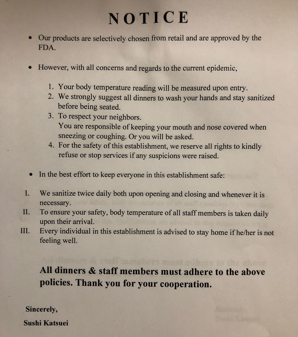 A photograph of a warning notice in a bathroom, detailing the cleaning habits of the staff and customers at a restaurant