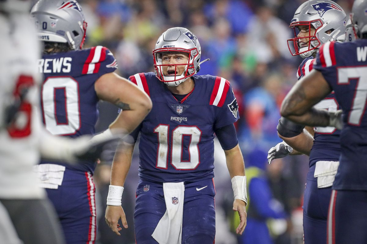 New England Patriots quarterback Mac Jones (10) reacts during the second half against the Tampa Bay Buccaneers at Gillette Stadium.