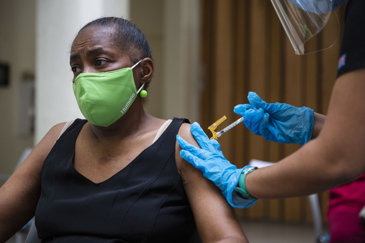Linda Blunt, 65, receives her first vaccination at Garden House Apartments in Maywood in March.