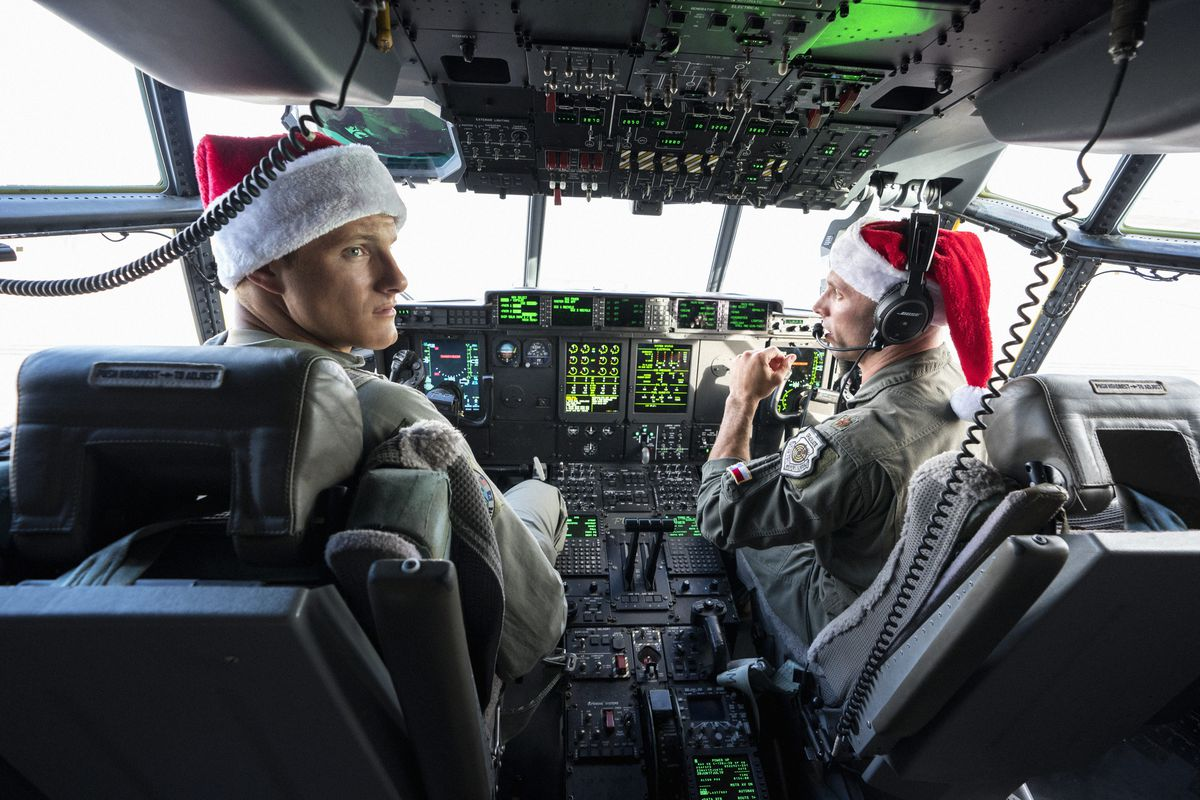 Alexander Ludwig as Andrew flying a plane in Operation Christmas Drop