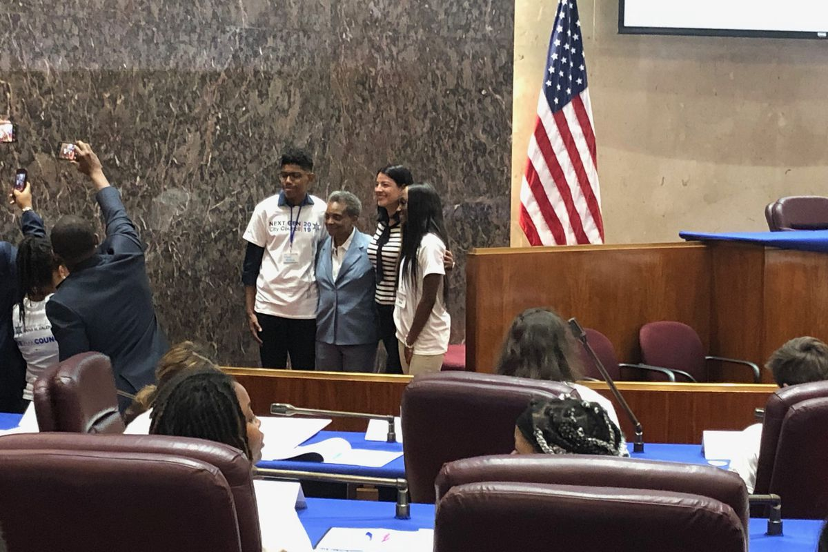 Lori Lightfoot addressed high school students and took photos with them in her first appearance at the Chicago City Council on May 23, 2019.