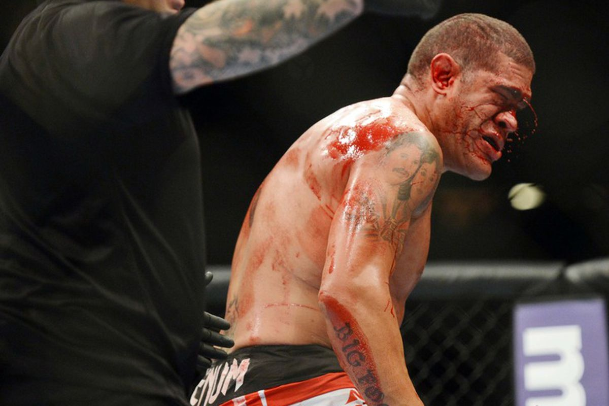 Don't make Cain Velasquez angry. You wouldn't like him when he's angry. Photo of a bloodied Antonio Silva by Ron Chenoy via US PRESSWIRE.
