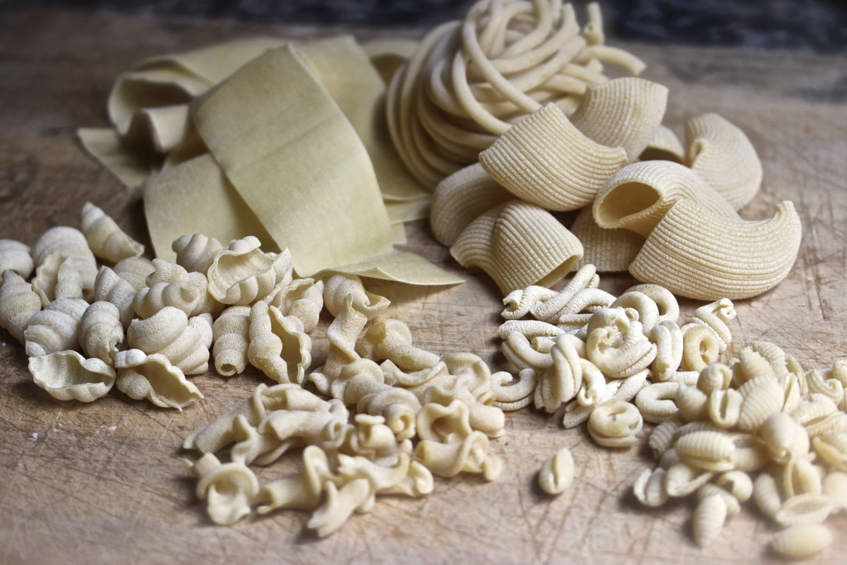 Freshly made pasta from Il Nido on a wooden counter