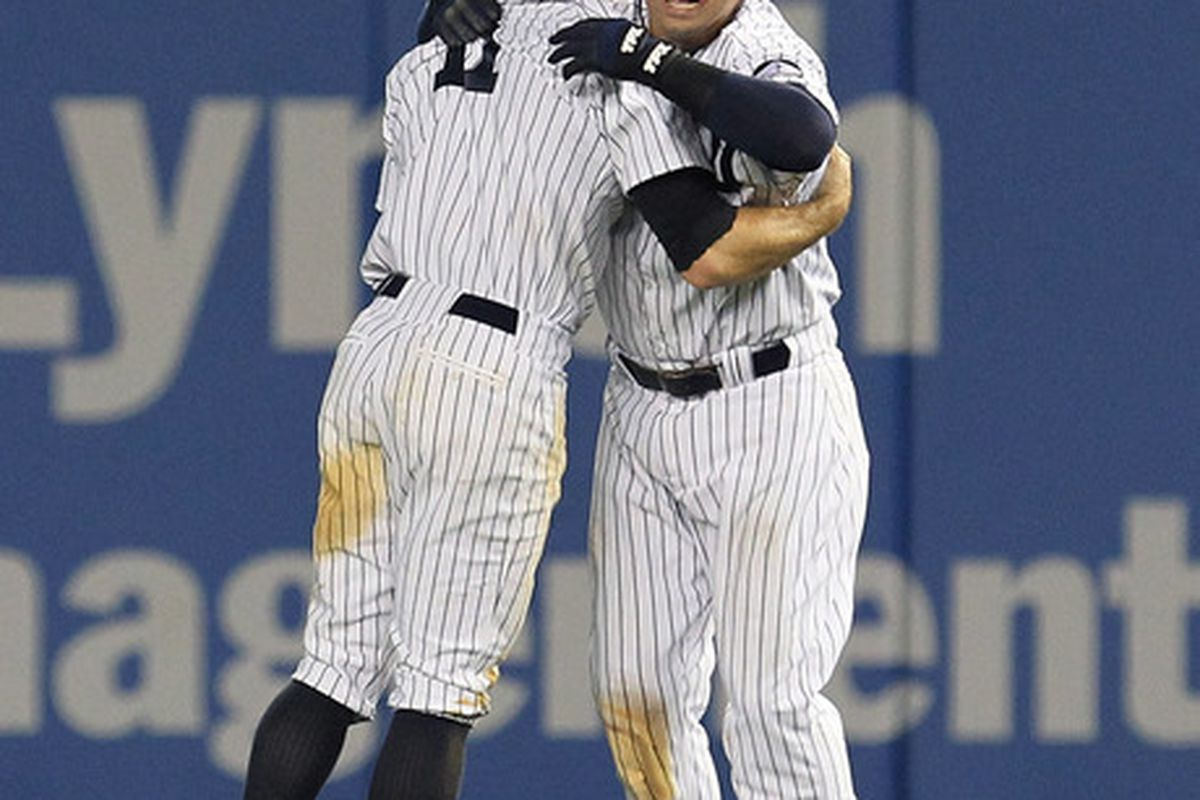 The Missing Man Formation: Nick Swisher embraces Brett Gardner. (Photo by Al Bello/Getty Images)
