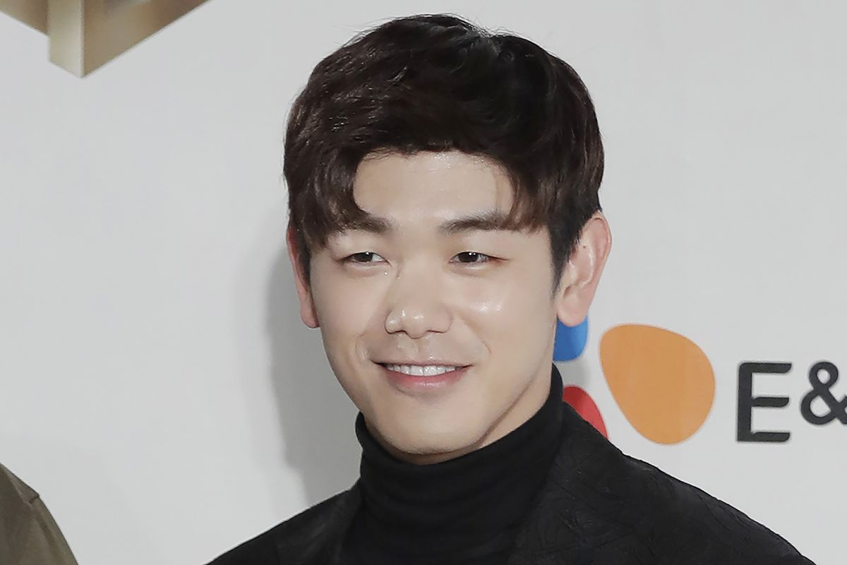South Korean-American singer-songwriter Eric Nam, poses for the photographers on the red carpet of the 2016 Mnet Asian Music Awards in Hong Kong.