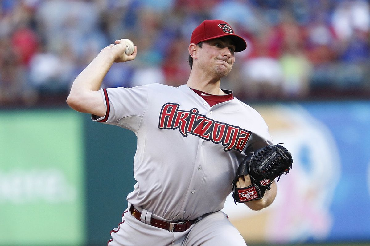 ARLINGTON, TX - JUNE 14: Daniel Hudson #41 of the Arizona Diamondbacks delivers a pitch against the Texas Rangers at Rangers Ballpark in Arlington on June 14, 2012 in Arlington, Texas. (Photo by Rick Yeatts/Getty Images)