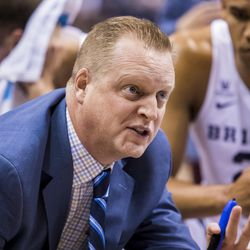 BYU assistant coach Quincy Lewis coaches during game against Colorado College on Nov. 8, 2017.