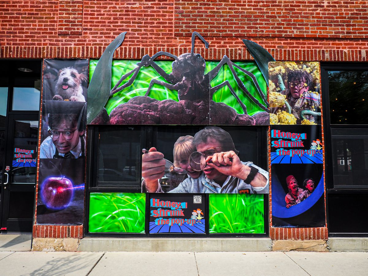 """The exterior of a bar storefront with lots of '80s movie nostalgia from """"Honey, I Shrunk the Kids."""""""
