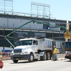 11:52 a.m. Contractor's street sweeping truck, cleaning inside one of the Clark Street gates -