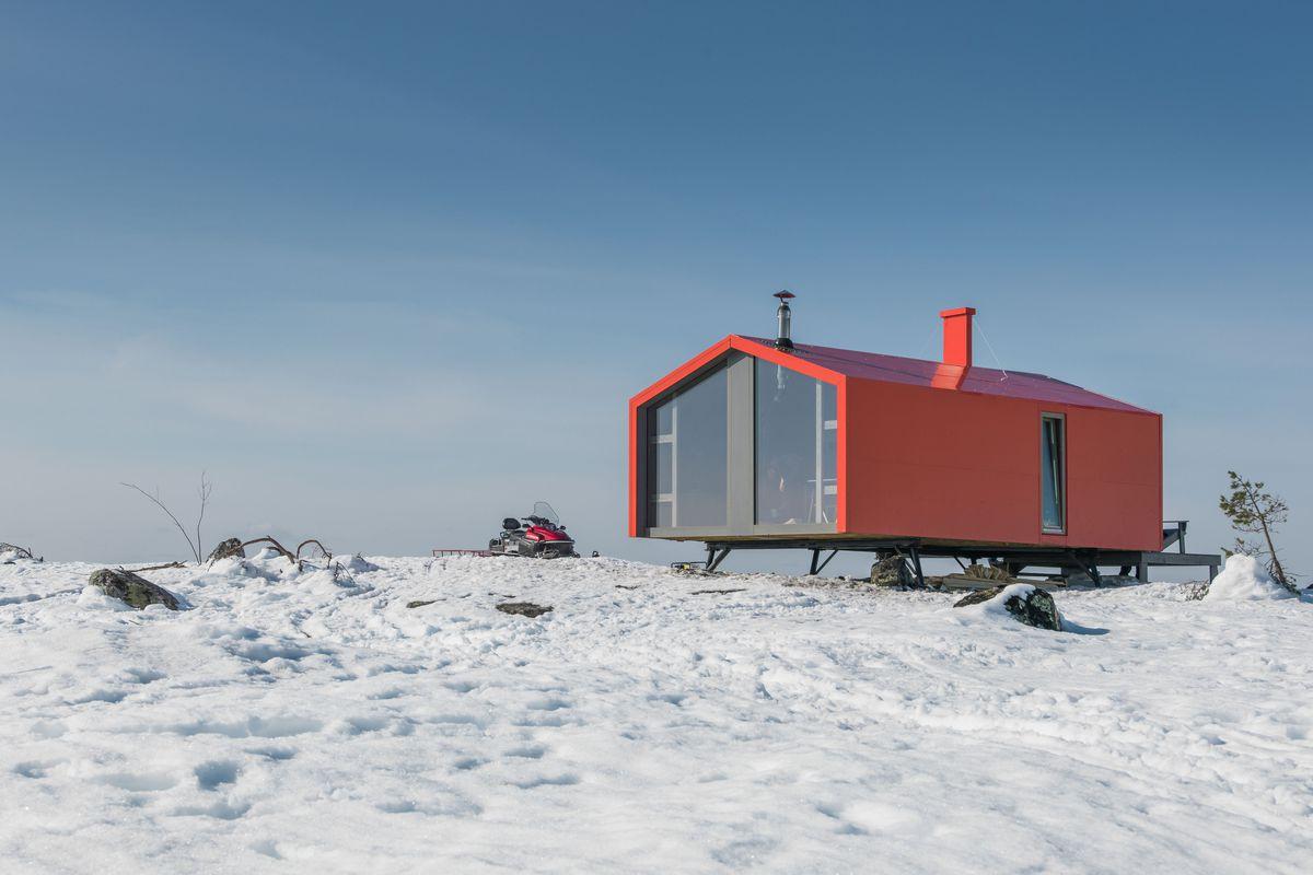 prefab cabin in snowy mountains