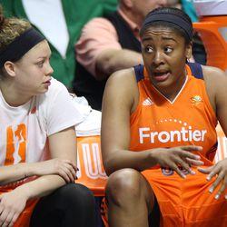 Connecticut Sun's Morgan Tuck (33) talks with Rachel Banham (1) on the bench.
