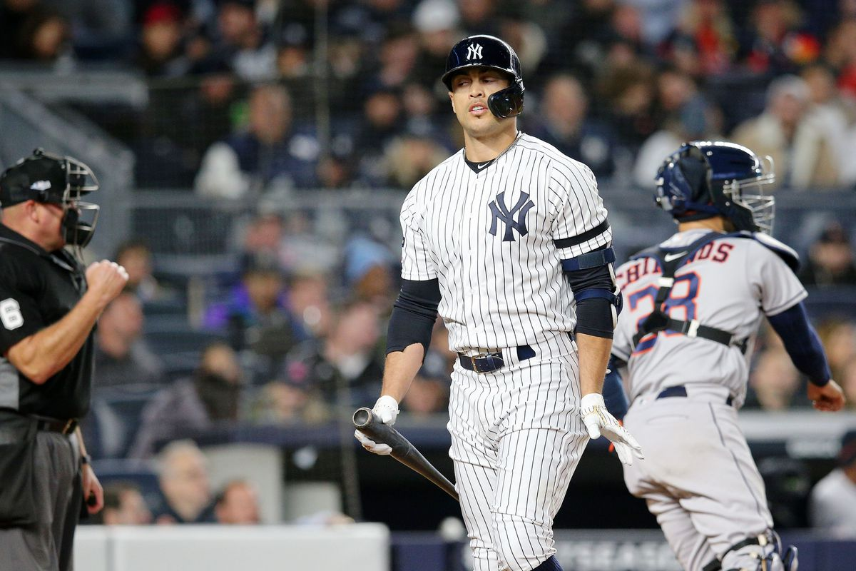 New York Yankees designated hitter Giancarlo Stanton reacts after striking out during the sixth inning of game five of the 2019 ALCS playoff baseball series at Yankee Stadium.