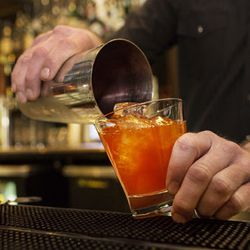 The completed New Fashioned is immediately poured into a double Old Fashioned glass.
